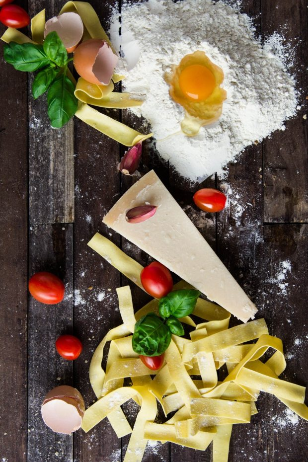 pasta-tomatoes-and-flour-with-egg-shells-on-table-35661