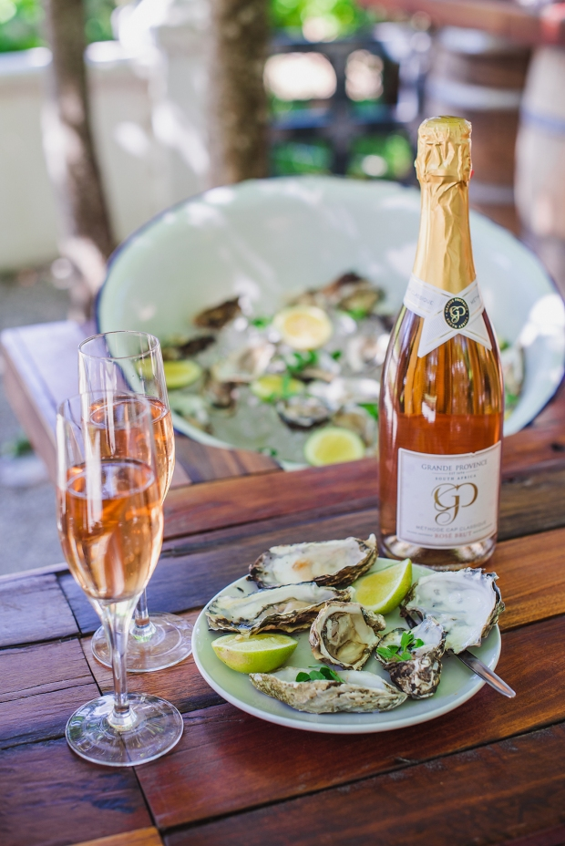 Grande Provence MCC and Oyster tasting portrait with bottle in focus HR